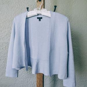 Shrug sweater with peplum hem